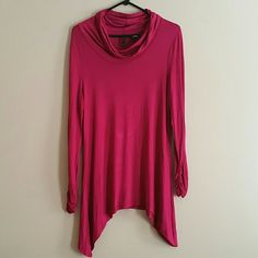 Beautiful  Cowl Neck Tops Transform your wardrobe with this  Beautiful Cowl Neck Top! Crafted with shark - bite hem,this flattering sweater is ideal for pairing with skinny  jeans and boots. ND Tops