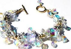 Send sparkles of light around the room with this bejeweled Swarovski crystal Braacelet. This Bracelet is adorned with sparkling cluster of varied sizes swarovski crystal AB, clear, G/F beads and G/FToggle Clasp. Sparkles, Swarovski Crystals, Beaded Jewelry, Jewelry Making, Sterling Silver, Beads, Elegant, Bracelets, Room