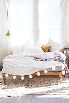 This bedroom has a moroccan boho feel to it and I love the pom pom throw with the berber style rug under the bed.
