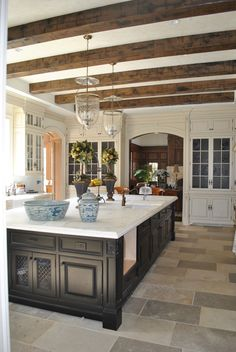 Black + white cabinets + lighting + iron grill cabinet front