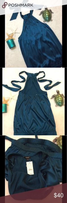 ✨HP✨🐢NWT Express Silk Teal Tie Neck Halter Top 🐢Express NWT $49.50 Size S Teal Adjustable Tie Neck  Halter Top Elastic Bottom Elastic On Center Back 93% Silk 7% Spandex  26in Neck to hem 15in Armpit to Armpit unstretched  20in Armpit to Armpit stretched  17in Bottom opening unstretched  23in Bottom Opening Stretched Express Tops Blouses