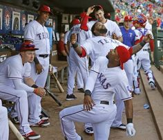 Texas Rangers shortstop Elvis Andrus (1) and designated hitter Prince Fielder (84) clown around in the dugout before the start of the game during the Oakland Athletics vs. the Texas Rangers major league baseball game at Globe Life Park in Arlington, on Tuesday, June 23, 2015. (Louis DeLuca/The Dallas Morning News)