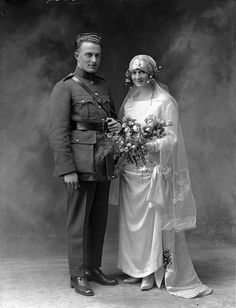 Patricia Foley married Major Michael Joseph Bishop on April 24, 1924 in Limerick Ireland. Patricia's veil, with it's delicate stitching really transforms her outfit, and is balanced perfectly with a quite simple but gorgeous wedding dress.