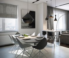 On the other end of the spectrum is this nearly futuristic space with chairs that pop and sleek, monochromatic design