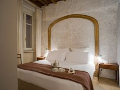simple headboard, trim only in metallic paint. Romantic Getaways - Find a hotel for a romantic escape - Design Hotels