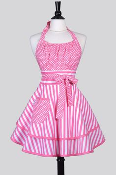 Who said cooking or cleaning had to be boring! This cute, flirty and fun pinup style womens kitchen apron is super cute in pink and white stripes and dots. A single pocket is perfect for stashing your phone. Details: ~ 100% Cotton ~ Machine Washable ~ One size fits most ~ Length: 28 / 71cm ~ Waist: 26 / 66cm ~ Lined Bodice, Waistband and Pocket(s) We believe in always putting quality first, which is why every single one of our aprons is individually handmade and packaged. We want y...
