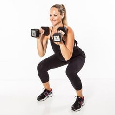 Hold dumbbells in front of shoulders, palms facing in. Lower into a shallow squat to gain power.