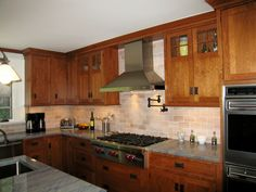 cherry mission-style cabinets, awesome hardware. Can we get this look?
