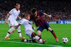 Lionel Messi of FC Barcelona duels for the ball with Nigel de Jong of AC Milan during the UEFA Champions League Group H match Between FC Barcelona and AC Milan at Camp Nou on November 6, 2013 in Barcelona, Catalonia.