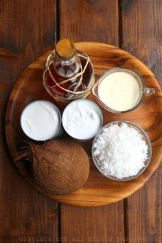 Homemade coconut ice cream recipe made with coconut milk, cream, sugar, fresh grated coconut, and dark rum. Served with roasted coconut shavings. Homemade Coconut Ice Cream, Coconut Milk, Ron, Ice Cream Recipes, Camembert Cheese, Popsicle Recipes, Easy Recipes, Deserts, Cooking