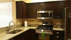 Upgraded my honey oak builder grade kitchen cabinets using General Finishes gel stain in Brown Mahogany smallkitchenredo Home Decor Kitchen, Diy Kitchen, Home Kitchens, Kitchen Dining, Kitchen Ideas, Kitchen Designs, Painting Oak Cabinets, Staining Cabinets, Cabinet Refinishing