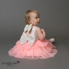 The Icy Pink Princess is perfect for the little girl who stands out in a crowd! The bodice is covered in iridescent white sequins over a hot pink fabric. Thre