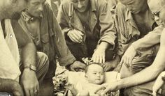 Saipan, 1944. Men of co. A 105th infantry regiment found a Japanese baby in a cave filled with dead civilians who committed suicide. New Dramatic Photos Thread (READ 1st POST) - Page 6
