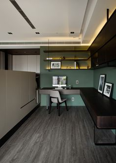 A small elegant office hides behind the entertainment console, making it easy for a working parent to interact with the children without sacrificing the quiet and concentration needed to get things done. Dark jade and muted wood tones foster a relaxing and tranquil environment.