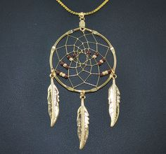 This beautiful necklace has a 1 inch diameter hoop. Copper and Gold seed beads are woven in a design in the web. Hanging from the hoop is 3 golden feathers. Comes with a nice plated gold chain. Dream Catcher Jewelry, Thing 1, Gold Beads, Beautiful Necklaces, Gold Chains, Feathers, Native American, Jewelery, Handmade Jewelry