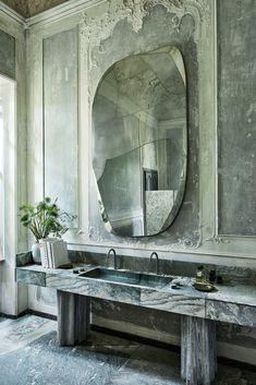 In the main ensuite, bespoke silvered brass mirror and custom cipollino apuano marble vanity with recycled fibreglass bases by Vincenzo de Cotiis.