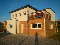 Maison Gico en Ossature bois avec finition extérieur bois/crépis et une toiture plate
