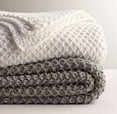 RH Baby & Child's Textural Knit Bed Throw:Destined to become an everyday favorite, our collection's distinctive stitch was inspired by patterns found in nature – while its vintage charm and comforting warmth were modeled after the heirloom bedding of earlier generations.