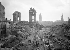 View taken in January 1952 from Dresden& Muenzgasse street showing people working on the removal of debris in front of the ruins of the Frauenkirche (Church of Our Lady). The church was reduced to rubble during World War II allied bombings. Nagasaki, Dresden Bombing, Fosse Commune, Empire State Building, Grand Parc, Church Of Our Lady, Dresden Germany, World War Two, Historical Photos