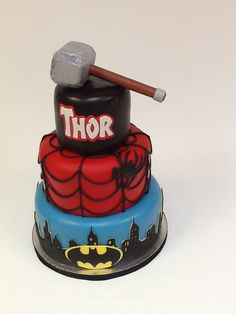 Batman, Spiderman, and Thor grooms cake! www.carriescakes.com