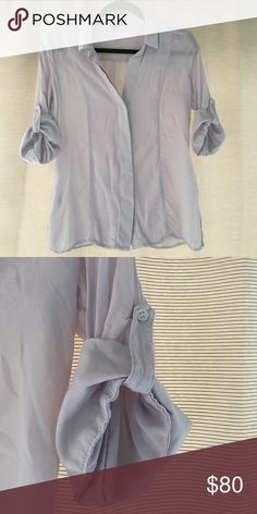 James Perse shirt Size: 1 (small) Pale purplish/grey collared shirt by James Perse. Hidden button up, deep v-Neck. Rolled 1/2 sleeves wth button clasp. 100% viscose. No signs of wear - EUC. James Perse Tops Button Down Shirts