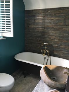 Bathroom in Farrow and Ball Vardo with the bath and cupboard in Mahogany