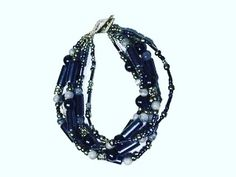 Charcoal Daisy Bracelet  Available at www.ellenivy.co.za  #beads #handmade #jewelry #fashion #handmadejewelry #bracelets #bracelet #beading #earrings #jewellery #accessories #necklace #jewelrydesigner #love #beadedjewelry #bead #charms #beadwork #crystals #gems #jewelrymaking #art #africanjewelry #madeinafrica #beadsbracelet #style #chunkybeads Beaded Jewelry, Handmade Jewelry, Jewellery, Beadwork, Beading, Daisy Bracelet, Chunky Beads, African Jewelry, Gem S