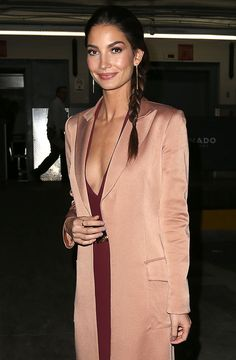 While an estimated 500 million people will watch Lily Aldridge strut down the Victoria's Secret runway on television tonight with a swingy head of bombshell waves, her sleek evening braid is a testament to the knockout chic of a less-is-more approach to hair.