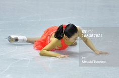 TOKYO, JAPAN - APRIL 11: Mao Asada of Japan falls during the ladies' short program during day one of the ISU World Team Trophy at Yoyogi National Gymnasium on April 11, 2013 in Tokyo, Japan.