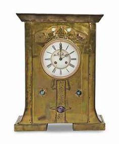 AN ART NOUVEAU BRASS STRIKING CLOCK,