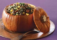 Dinner in a Pumpkin! I prob used a 10 lb pumpkin, I added red pepper and only did 8oz mushrooms, and maybe half a bag of spinach. Used about 3.5C cooked wild rice/quinoa blend to mix it all together, and then baked in pumpkin. It was the perfect amount of filling! Note for next time, TOO much oil in pumpkin to begin roasting with! I'll try it with broth instead next time. The oil leaked through and soaked the bottom of the pumpkin :/