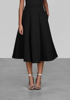 Sophisticated A-line skirt that reaches an attractive mid-length.