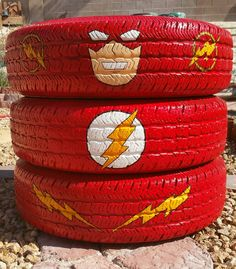 Tire The Flash superhero character from old car tires. Spray paint and acrylics. School super hero project. DYI recycle tire garden planter or yard art. Tire craft. Image only.