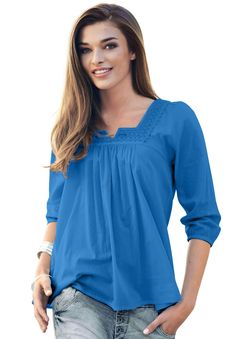 """Ellos® has redefined the plus size blouse with European flair. This woven cotton top is feminine and stylish with a fit that is comfortable for any activity or occasion. spacious silhouette is feminine and guaranteed to give you room to move28"""" length falls comfortably to below the hipssquare scoop neck is open and coolset in 3/4 blouson sleeves are roomy at armholes and expertly shaped for perfect ease of movementshirring for extra easesoft, washable woven textured cottonimported ..."""