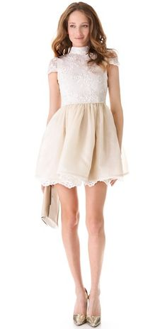 I'm a sucker for lace and an open back... look at the lace detailing on the underlay! So cute! alice + olivia dress