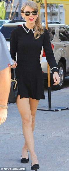 Taylor Swift wore a Reformation Jam Dress in black.  http://news.instyle.com/2014/01/21/steal-her-style-taylor-swifts-perfectly-retro-dress/