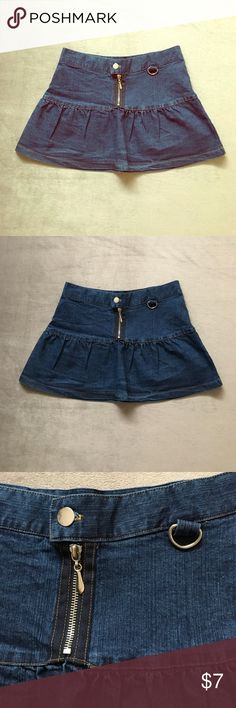 "NWOT Pleated Denim Mini This adorable skirt is brand new and has never been worn!  It measures approximately 13.5"" across at the waist and and 12"" in length lying flat.  Pleated front and back, zip fly, button closure.  Price is firm unless bundled. Abby z. Skirts Mini"