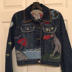 Fantastic See by Chloe Jean Jacket Embroidered with several animals, beach scene, fire breathing dragon , the world, sun, rain with lightening,  cactus, stars, clouds and a space ship. You will get noticed in tjisjacket! Silver tone buttons with crystal center.  Excellent condition. All my items are authentic. See by Chloe Jackets & Coats Jean Jackets