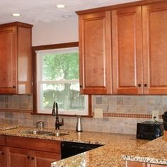 Kitchen Remodel with Mid Continent Towne Doorstyle and St. Ceclia Granite by Hatchett Design/Remodel