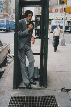 I had only heard that people once used private talking booths decades ago.  Helen Levitt. New York, 1971.