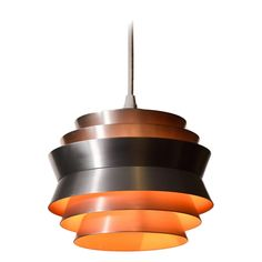 Danish Modern Six-Tiered Pendant | From a unique collection of antique and modern chandeliers and pendants at https://www.1stdibs.com/furniture/lighting/chandeliers-pendant-lights/