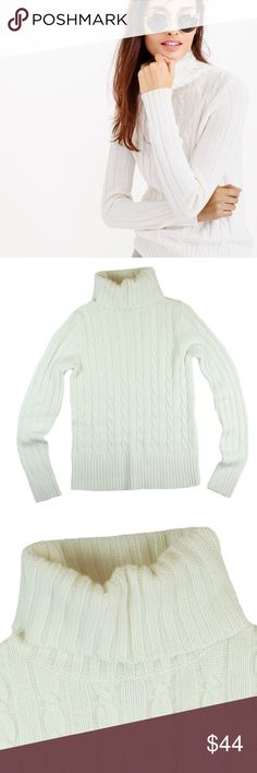 """JCREW Ivory Cambridge Cableknit Sweater Mint as new condition. From holiday 2015 season. This eggshell Ivory Cambridge cable knit sweater from JCREW features a turtle neckline. Made of a wool blend. Measures: bust: 35"""", total length: 25"""", sleeves: 26"""" J. Crew Sweaters Cowl & Turtlenecks"""