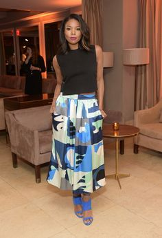 Gabrielle Union in a black blouse and printed Novis skirt at the ELLE Women in Television Celebration