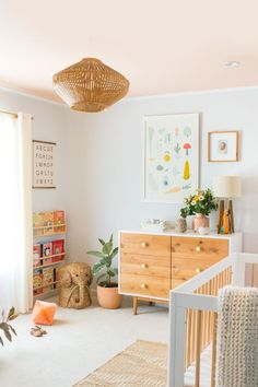 Beautiful neutral pastel nursery for a little girl.