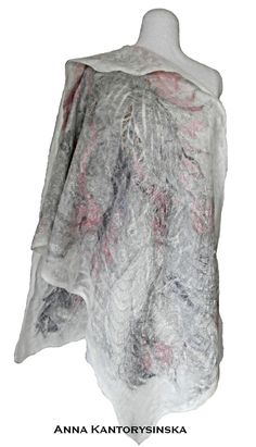 Felted silk shawl FLAMINGO in subtle pastel colors. Light and delicate as the wings of a bird .. Get wrapped up in a cool spring evenings. Soft and pleasant to the touch. On the creamy white background a lot of precious shades of pink and gray. Drawing from a variety of silk creates a unique, one-of-a-kind design. Made of thin silk chiffon, merino wool and silk fibers. Made exclusively in a single copy.  154 USD…
