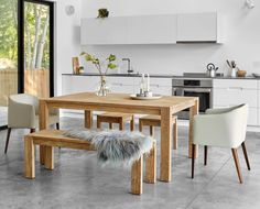 "Contemporary rustic nordic style dining room design from Scandis . The Sammer 65"" dining table is simple in design and full of benefits - featuring reinforced legs, leveling feet and solid wood construction. Crafted from solid reclaimed teak wood with a natural finish, the Sammer collection offers a taste of true Scandinavian style. Clean lines are embraced by the simplicity of the materials, creating perfect harmony. The effect is a versatile investment piece that will look great in any…"