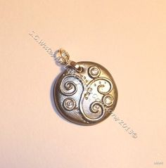 Celtic design polymer clay pendant....would make me a great Christmas present, Jalyn!!