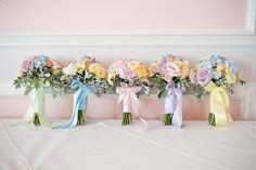 Pastel bouquet / posey with different coloured ribbon wrapped around each one - Pastel Wedding With Ribbon Details At Hunton Park With Bride In Original Always Forever Designed Gown And Bridesmaids In Pastel Gowns From Kelsey Rose With Groom And Groomsmen In Suits From Hugh Harris And Images By Fiona Kelly #weddings #wedding #marriage #weddingdress #weddinggown #ballgowns #ladies #woman #women #beautifuldress #newlyweds #proposal #shopping #engagement