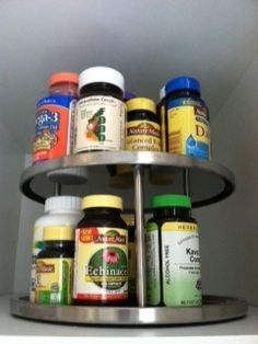 Organize vitamins - store vitamin and supplement bottles on a turntable in a kitchen cabinet away from sunlight. #organizing #vitamins