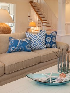 A spot of color and three patterns goes a long way to energize this neutral room! - Malibu Cottage -